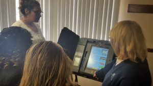 New latino voters in Painesville learning to use a voiting machine with Jan Clair, Lake County Board of Elections.